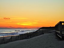 Winter sunset. Sunset beach sand winter ocean Royalty Free Stock Photo