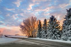 Winter sunset on a country road leading to the farm stock image