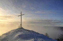 Winter sunset cross hill top. The cross on top of a mountain at winter sunset. Krusne Hory, Velky Spicak - Czech Republic Royalty Free Stock Photography
