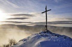 Winter sunset cross hill top Stock Photo