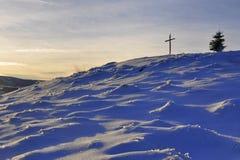 Winter sunset cross hill top Stock Photos