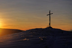 Winter sunset cross hill top. The cross on top of a mountain at winter sunset. Krusne Hory, Velky Spicak - Czech Republic Royalty Free Stock Images