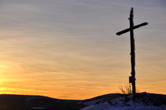 Winter sunset cross hill top Stock Photography