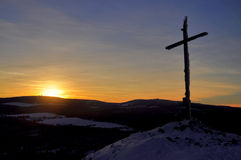 Winter sunset cross hill top Stock Images
