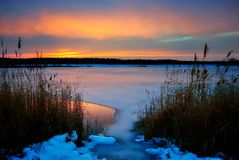 Winter sunset on a frozen lake. Covered with snow Stock Images