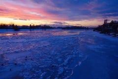Winter Sunset On Frozen River Stock Photo