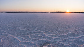 Winter sunset at frozen sea stock photography