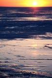 Winter sunset on the ice of Lake Stock Photos