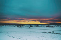 Winter sunset landscape Stock Photos