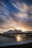 Winter sunset long exposure over Brighton pier. Royalty Free Stock Image