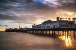 Winter sunset long exposure over Brighton pier. Royalty Free Stock Photography