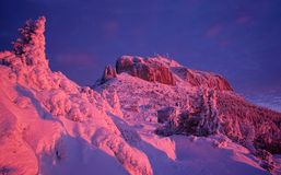 Winter sunset in mountain of Ceahlau royalty free stock photo