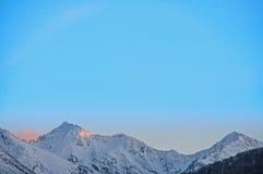 Winter sunset on mountain ridge Royalty Free Stock Photos