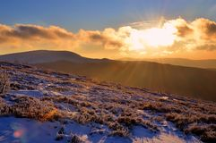 Winter sunset in mountains Stock Photos