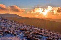 Winter sunset in mountains Stock Images