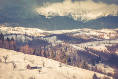 Winter sunset with mountains in Transylvania Royalty Free Stock Photo