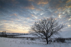 Winter sunset near Romanian village Stock Photo