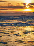 Winter sunset over Baikal lake Royalty Free Stock Image