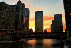 Winter sunset over the Chicago River in the loop during evening commute. Winter sunset over the Chicago River in the loop during evening commute on a January Royalty Free Stock Photography