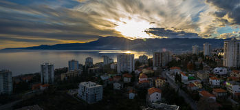 Winter Sunset over The City. Rijeka, Croatia, photographed from Apartment Window at afternoon Royalty Free Stock Photos