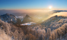 Winter sunset over the clouds Royalty Free Stock Photography