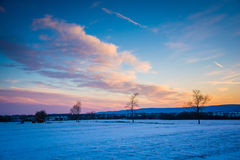 Winter sunset over a farm field in rural Frederick County, Maryl Stock Photography