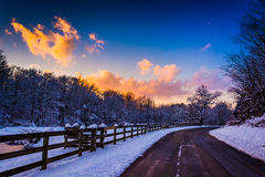 Winter sunset over a fence and country road in rural York County Stock Photography