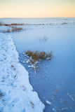 Winter sunset over frozen pond Royalty Free Stock Photography
