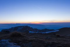 Winter sunset over the mountains. Sunset over the mountains, view from Omu cabana in Bucegi mountains, Romania Stock Photography