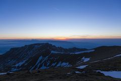Winter sunset over the mountains royalty free stock photos