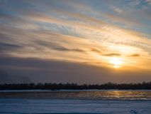 Winter sunset over the Ob River with clouds, Novosibirsk, Russia stock photography