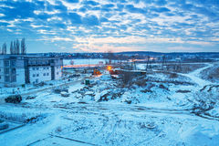 Winter sunset over snowy meadow. In Poland Royalty Free Stock Photography