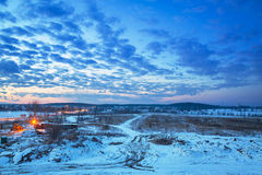 Winter sunset over snowy meadow Royalty Free Stock Images