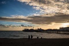 Winter sunset over Victorian pier in Brighton. Stock Images