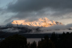 Winter sunset on remarkables. Sunset accross snow covered peaks of remarkables mountain range, queenstown, new zealand Royalty Free Stock Images
