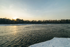 Winter sunset in river. Royalty Free Stock Images