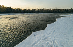 Winter sunset in river. Stock Photography