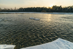 Winter sunset in river. Royalty Free Stock Photos