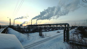 Winter sunset with smoke pollution. Thermal station smoke in sky at winter sunset in Russia stock video footage