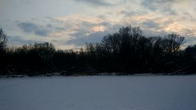 Winter sunset timelapse at the river stock footage