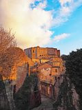 The beautiful medieval village of Sorano, Italy. A winter sunset view of the ancient medieval city of Sorano located in Tuscany, Italy Royalty Free Stock Photography