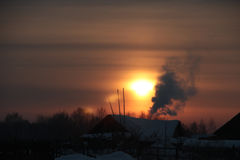 Winter sunset in village Stock Photo