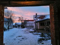 Winter Sunset in the village stock photo