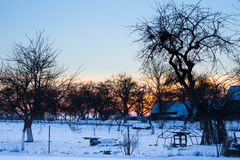 Winter sunset in village Stock Images