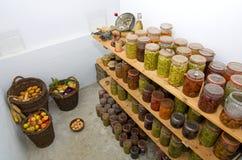 Winter supplies. Winter food supplies in rural basement cellar Stock Photography