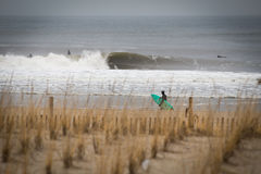 Winter Surf Session at Rockaway Beach NY stock images