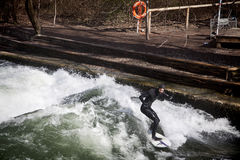 Winter surfing on the Eisbach river at Englischer Garden in Mun royalty free stock images