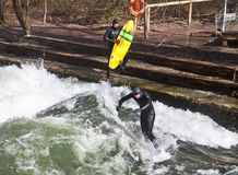 Winter surfing on the Eisbach river at Englischer Garden in Mun stock photo