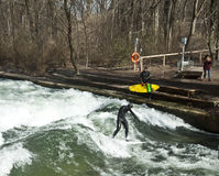 Winter surfing on the Eisbach river at  Englischer Garden in Mun Stock Photos