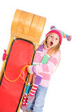 Winter: Surprised Girl Stands With Toboggan Royalty Free Stock Images